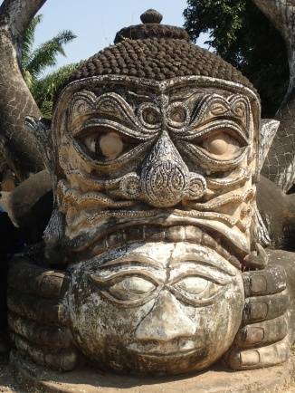 Eclipse (moon eating the sun), Buddha Park, near Vientiane, Laos