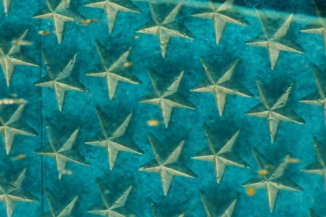 Stars on Freedom Wall reflected in pool