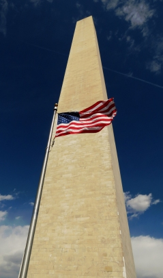 The United States flag in front of the Washington Monument