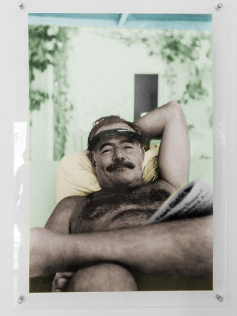 Photo of Hemingway beside the pool
