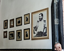 Wall of La Bodeguita del Medi with photographs of Ernest Hemingway