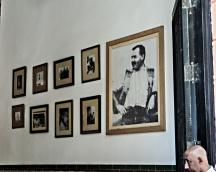 Wall of La Bodeguita del Medi with photographs of Ernest Hemingway