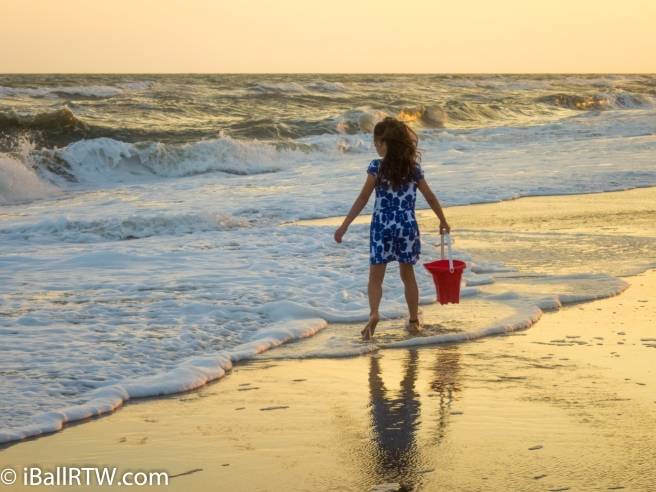 Little Girl with Red Beach Pail