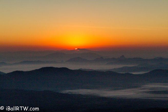 The sun peeking over the mountains